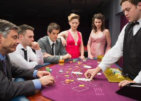 Blackjack players concentrating